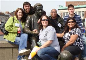 Honors students around a statue